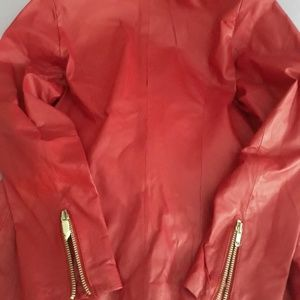 Leather, red zippered jacket and matching skirt